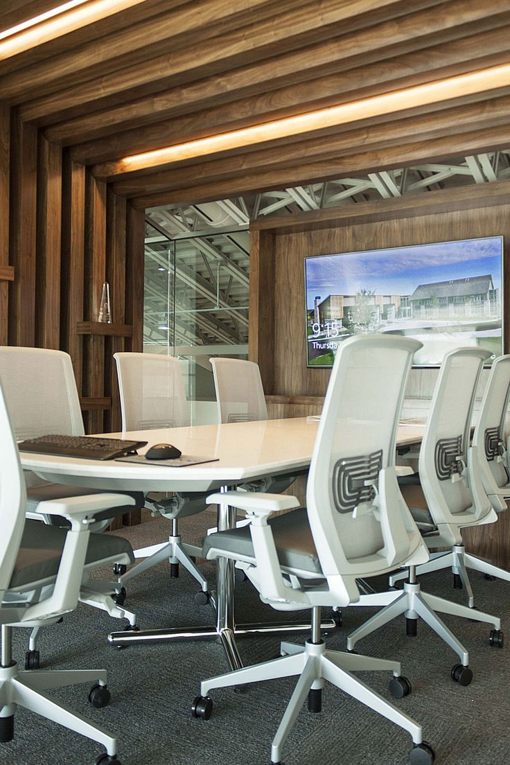 OakWood's new corporate headquarters was designed by Hobin #Architecture.  Glass-walled conference rooms and modular #furniture bring the #building together.