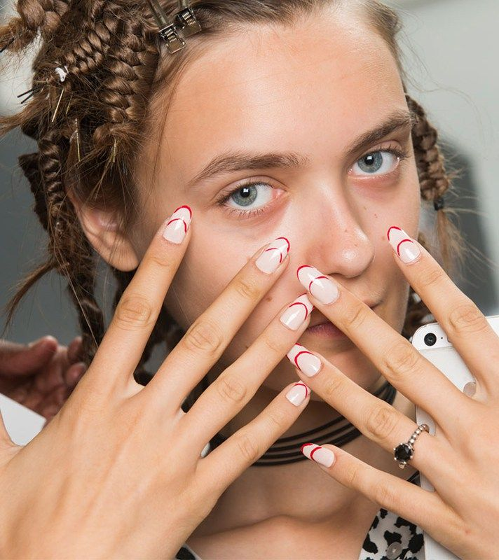 Browse the best nail art ideas from fashion month Spring 2017 at @StyleCaster | Carmen Marc Valvo's nude nails with red tip stripes