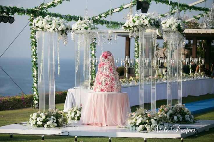 A Luxury Bali Wedding at Private Villa in Bali, Acrylic Pillars with flowers for wedding cake, look so perfect.