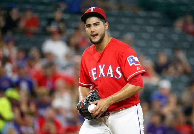 Martin Perez reacts after an umpire's controversial call is reversed in the sixth inning vs. the Angels on Monday, September 19, 2016. (Louis DeLuca/The Dallas Morning News)