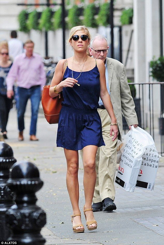The 29 year old showed off her tan in a silk strappy dress, which she offset with a pair o...