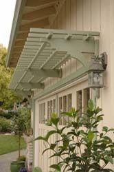 arbor over garage door... lovely idea