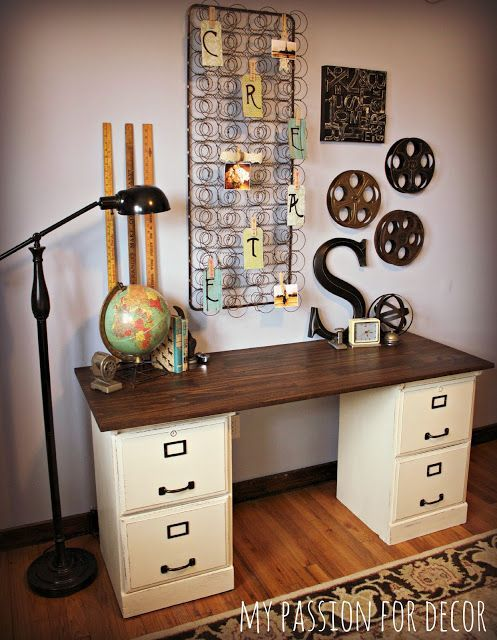 I love the desk, the lamp, the globe, the   yardsticks, and the mattress springs.  Would never have thought to hang mattress   springs on the wall.