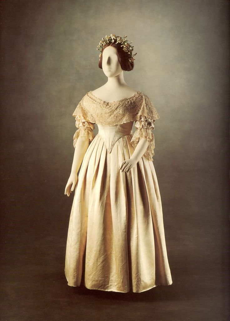 'I wore a white satin dress, with a deep flounce of Honiton lace, an imitation of an old design. My jewels were my Turkish diamond necklace & earrings & dear Albert's beautiful sapphire brooch.' — Queen Victoria describing her wedding outfit in her journal. The dress itself was designed by William Dyce and was created from a heavy ivory satin woven in Spitalfields, London while the lace came from Honiton in Devon