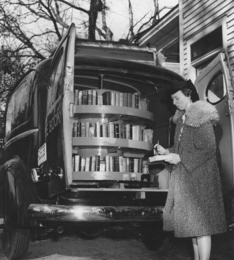 Susan Borden, Wayne County, North Carolina's first librarian, checks the bookmobile, 1941.