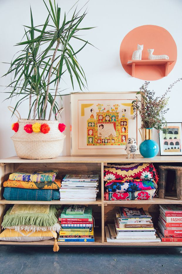 Bright colours, pom poms and patterns in a happy and relaxed, boho studio in L.A. Justina Blakeney.