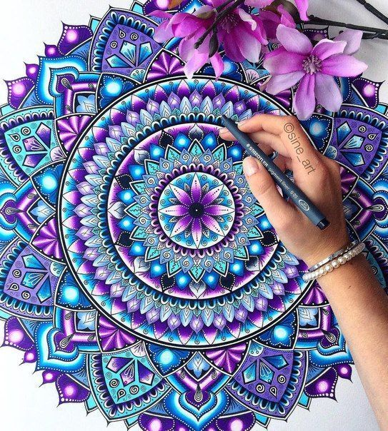 beautiful mandala with stunning colors in turquoise and purple