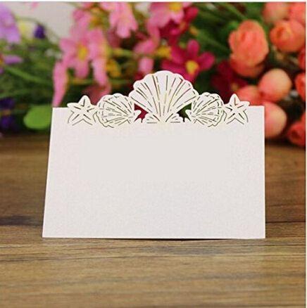 """安い48 パック ビーチ を テーマ に し た結婚式の場所カード レーザー カット海シェル貝殻結婚式夏ビーチテーマウェディング、購入品質イベント & パーティー用品、直接中国のサプライヤーから:材料: pearlecent厚紙用紙パターン: レーザーカット海シェル貝殻場所カード色: 白、 量: 48折られたサイズ: 約。"""" 3.6x2.6"""" 製品の説明 頂上に設定されテーブル番号、"""