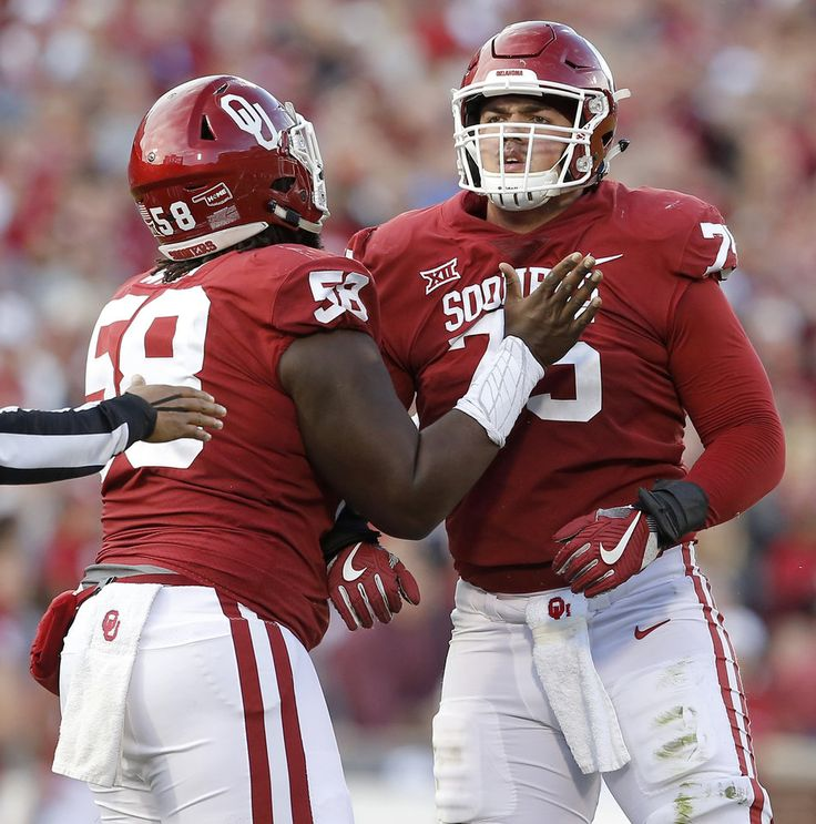 Oklahoma's Erick Wren (58) holds back Dru Samia (75) after Samia was called for a personal foul during a college football game between the Oklahoma Sooners (OU) and the West Virginia Mountaineers at Gaylord Family-Oklahoma Memorial Stadium in Norman, Okla., Saturday, Nov. 25, 2017. Oklahoma won 59-31. Photo by Bryan Terry, The Oklahoman