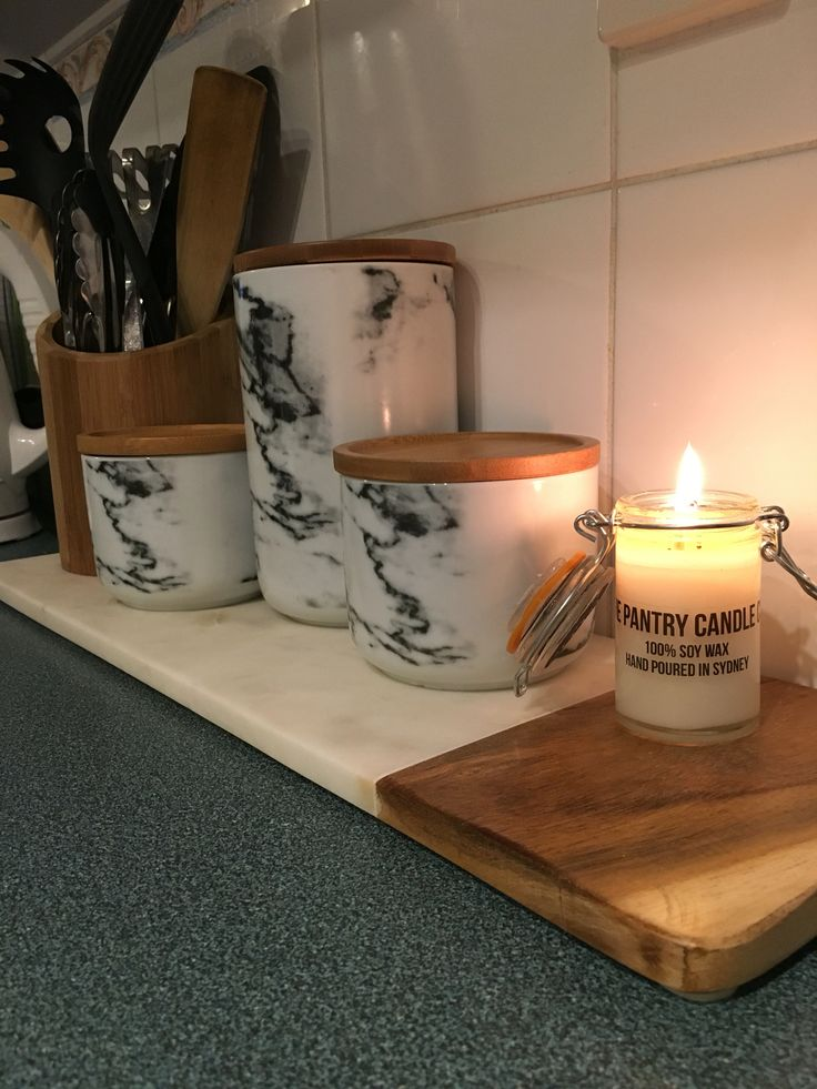 Big W canisters, Kmart chopping board and the pantry co soy candle. Yum  My kitchen on a Sat night