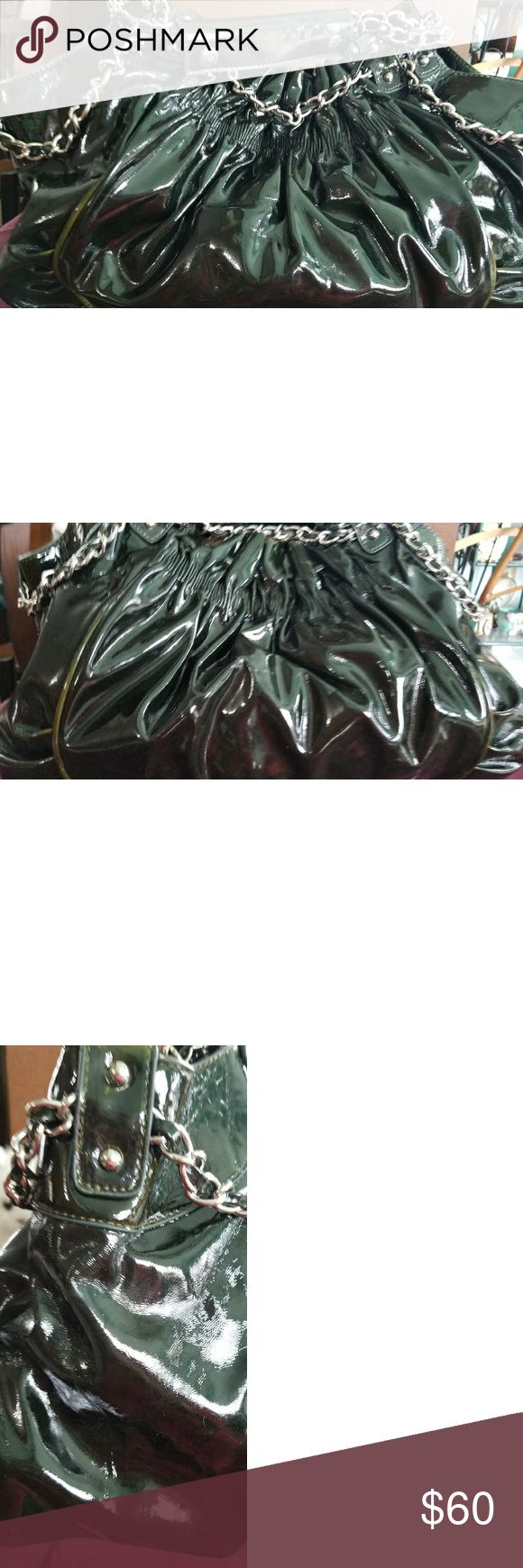 VINTAGE Bagtique faux patent leather slouch purse Black slouch bag large with silver chain strap and adornment.  Has floral cotton fabric lining. Inside has zippered divider and 2 slide in pockets on 1 side and a zippered back on other. Black with olive green tipped as shown in picture. Preowned excellent condition bagtique Bags Satchels