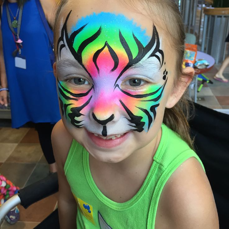 Rainbow Tiger face Paint Cincinnati face painters  Eva Wheeldon