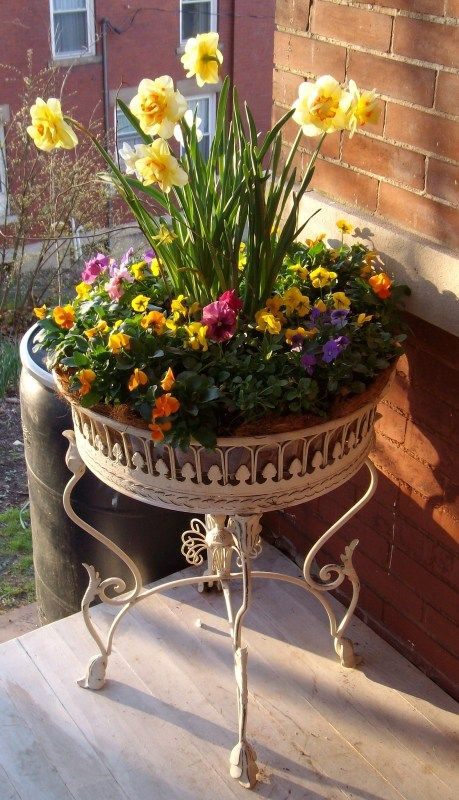 Love this metal planting table.  So Victorian!  It's one of my favorite garden accessories.