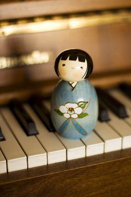 Japanese Kokeshi doll's are so charming. I have three of my own but I'd like more.