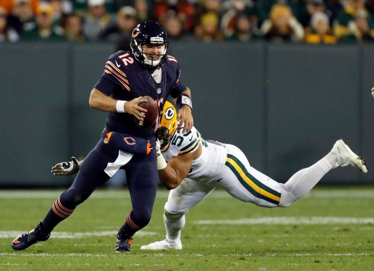 Thursday Night Football: Bears vs. Packers  -  October 20, 2016  -  26-10, Packers  - Chicago Bears quarterback Matt Barkley (12) tries to avoid a sack by Green Bay Packers outside linebacker Nick Perry (53) during the second half of an NFL football game, Thursday, Oct. 20, 2016, in Green Bay, Wis.