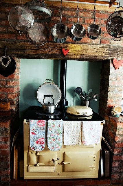 Aga by mazhawes, via Flickr  by mazhawes  The has the brick surrounding the oven with half walls.  Very cool.