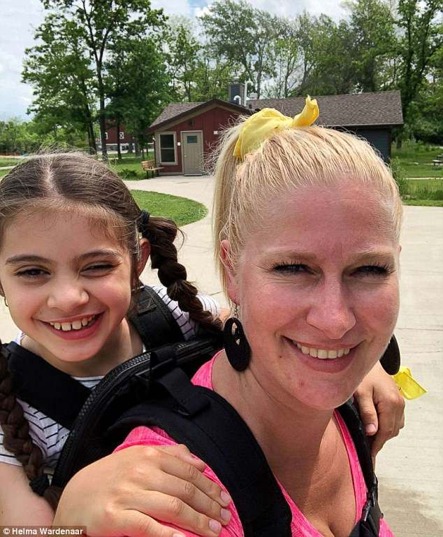 Amazing' teacher carries girl, 10, with cerebral palsy on