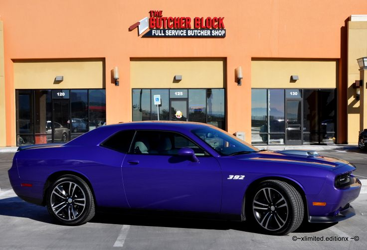 2014 Dodge Challenger Core 6 speed manual, with a 6.4 Liter,V8 SRT Hemi engine 392 and a Cervini Shaker Hood.  It is Plum Crazy Purple, with a custom white Katzkin leather interior like a retro 1970 Dodge Challenger.  And...it's mine!
