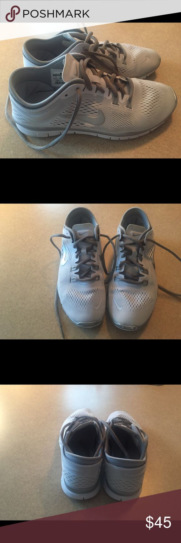 Women's Nike Shoes size 7 Women's Nike shoes-used-worn a few times. They are white and grey size 7. Nike Shoes Athletic Shoes