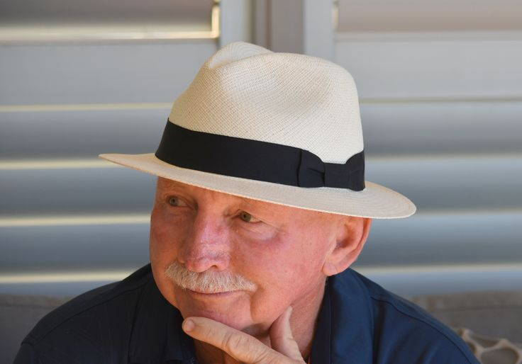 L1M1AS2  Nikon D7200 , 55-3000 mm with assigned settings.  changed the colour shirt, put on a Panama hat and looked away a bit. lighting was a little better as camera moved around to the left. Short tripod to drop the shot level. different day but still soft shade and greys with our veranda decor etc.