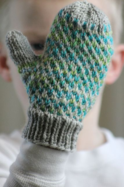 These thick, warm mittens are made with two colors of worsted weight yarn and size