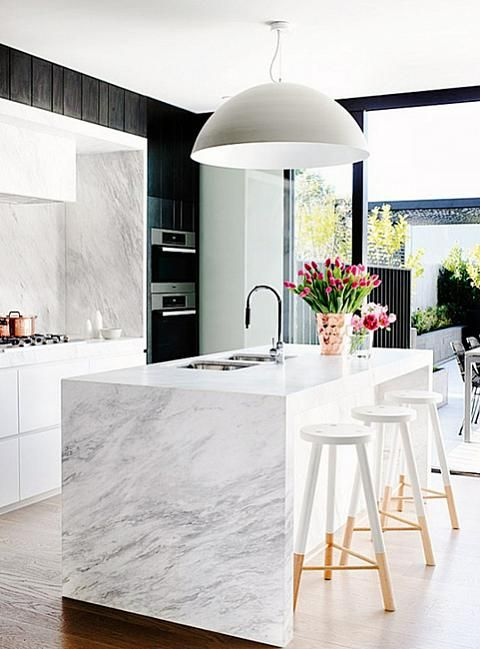 A waterfall countertop creates clean lines in the kitchen.