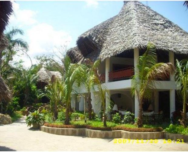 Scorpio Villas -are set in 3 acres of tropical gardens on the outskirts of Malindi town. A small path from the Villas leads to a dazzling white beach.  Cottages are privately screened by the imaginatively landscaped gardens and furnished in old Lamu style hand-crafted furniture including a 7 foot four poster bed.