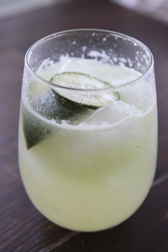 Seaside Kitchen: Caveman Cocktails!  1 shot good tequila  2 tbs cucumber puree*  Juice from 1 lime  Perrier   Ice cubes  Lime wedges and cucumber slices for garnish