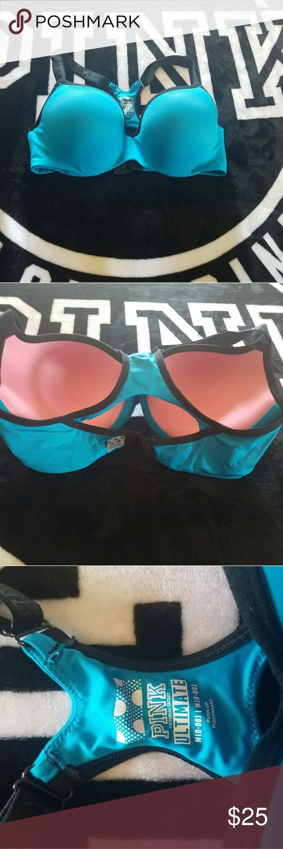PINK ULTIMATE racerback push up sports bra D-DD Size medium D-DD ULTIMATE racerback push up sports bra . Never worn but was washed once. Has a tiny snag on one cup. Be sure to check out my closet as I have lots of other pink items for sale. PINK Victoria's Secret Intimates & Sleepwear Bras