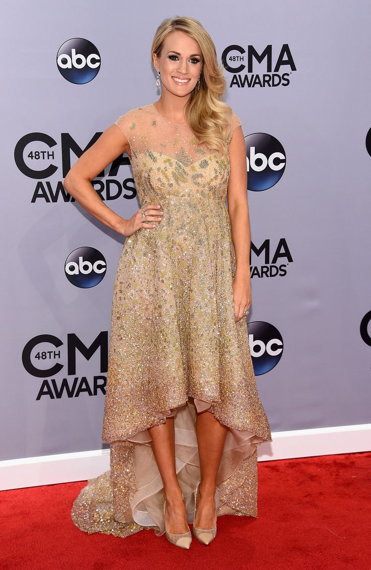 Carrie Underwood flaunted her bump in a sparkly gown at the CMA Awards