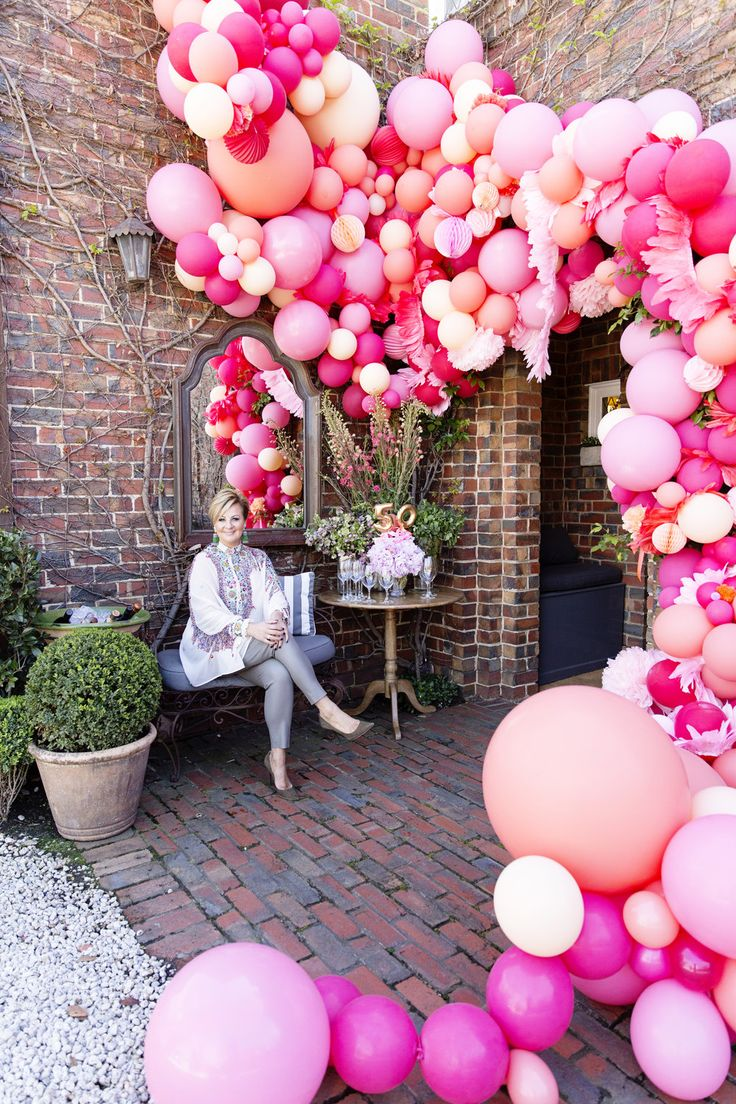I wanted to give a modern twist on the typical balloon arch, and with the help and cleverness from the girls from Poppies for Grace, the most amazing balloon installation was created.