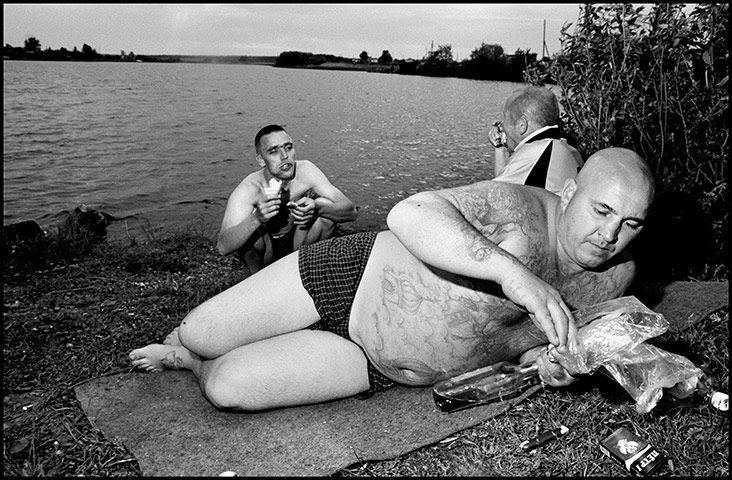 Sergey, or Wild Boar, 33, at a picnic. 'I used to be 100% gangster,' he told photographer Bruce Gilden. 'Now less than 100.' Bruce Gilden/Magnum Photos