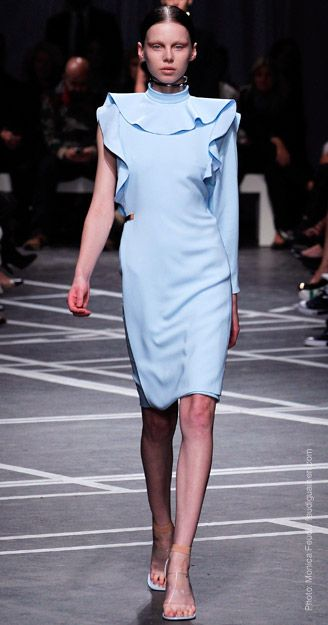 SPRING 2013 TREND REPORTS  EVERY FLOUNCE COUNTS  Designers reclaimed the ruffle this season: Deep frills edged necklines at Gucci and Givenchy, while the thigh-high slits of skirts at Balenciaga were flounced flamenco-style.    Givenchy    Balenciaga    Gucci