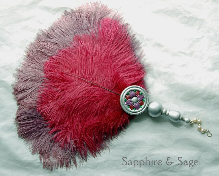 Christine Renaissance Feather Fanwww.sapphireandsage.com Wispy, soft ostrich feathers with shimmering peacock accents.  Choose two ostrich feather colors and one accent paint color for your custom fan.  Hand-painted wood medallion on a hand-crafted wood handle.  Excellent for hot Renaissance faire days, it moves air very well to help keep a Lady cool.