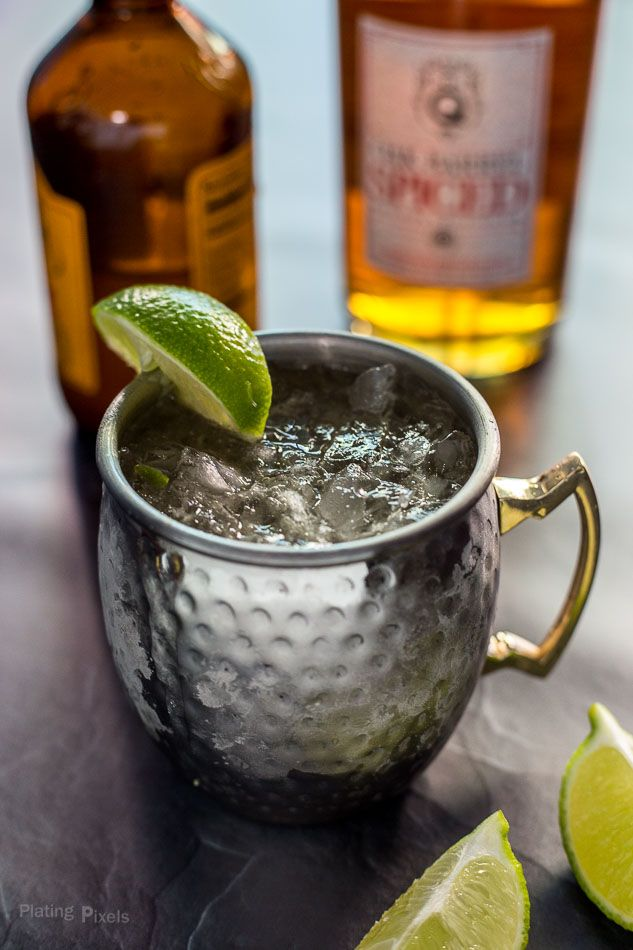 This easy Spiced Caribbean Mule Cocktail recipe is made from scratch. Includes a homemade ginger simple syrup, ginger beer, lime and spiced rum. - platingpixels.com