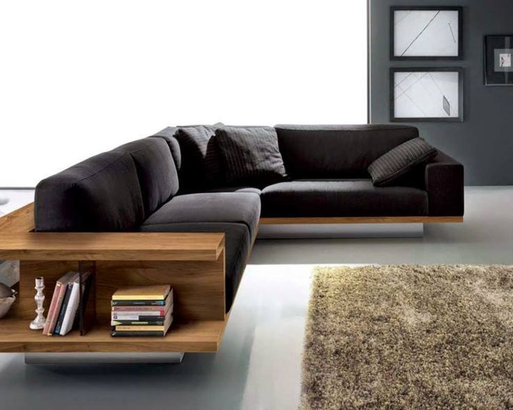 Living Rooms Minimalist Living Room With L Shaped Black Sofa Feat Book Storages Near Fluffy Rug Livin Wooden Sofa Designs Sofa Couch Design Modern Sofa Designs #sofa #set #living #room #design