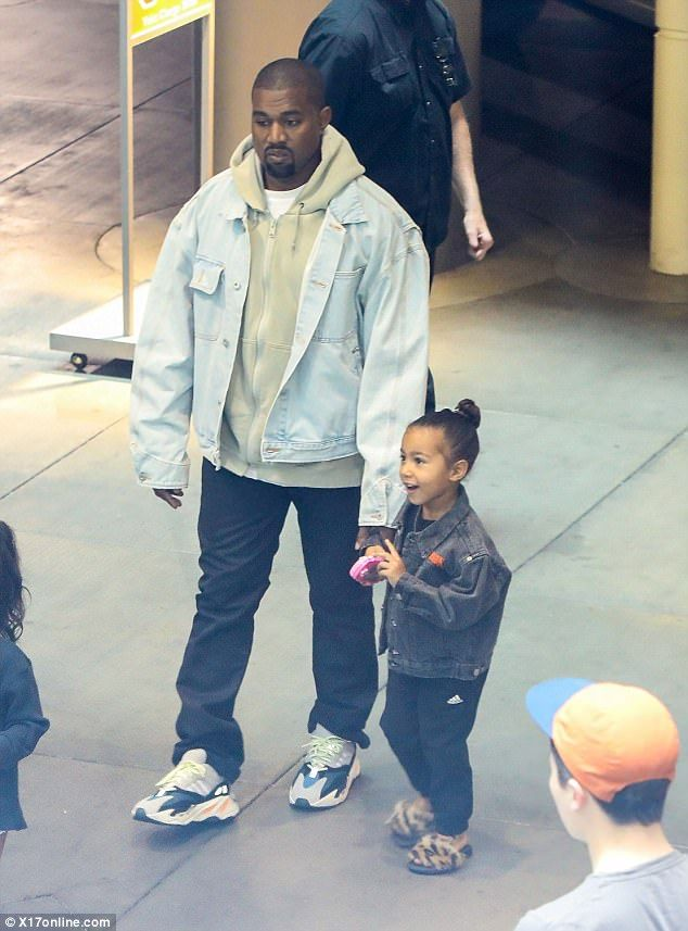 Film club: Holding his little girl's hand, the 40-year-old rapper treated his four-year-old daughter to a movie screening