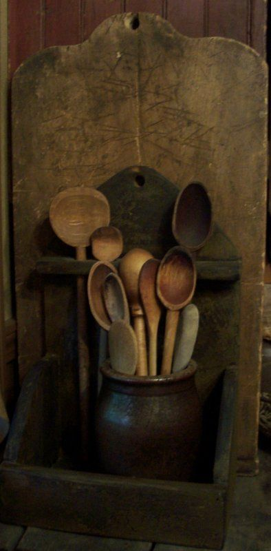 Early wood spoons in a prim wooden box and big cutting board..vignette.