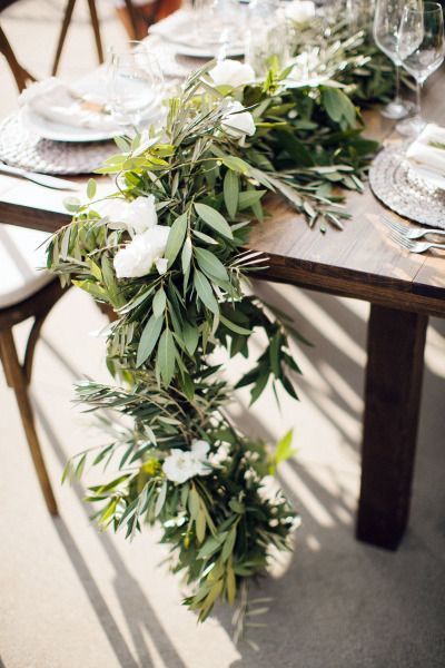 Beautiful garland: http://www.stylemepretty.com/living/2014/11/12/al-fresco-wine-and-cheese-dinner-party/ | Photography: Steve Steinhardt - http://stevesteinhardt.com/