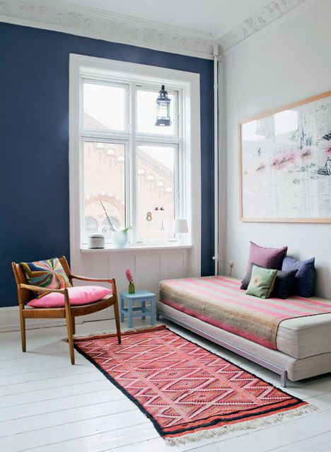 Vaulted Ceilings, Navy Accent Wall, Large Windows, White Painted Floors, Firm Daybed with Striped Throw, Oversized Art Print, Patterned Area Rug // pink