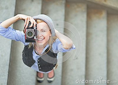 Happy Hipster Girl Making Photo With Retro Camera On City Street - Download From Over 50 Million High Quality Stock Photos, Images, Vectors. Sign up for FREE today. Image: 33849400