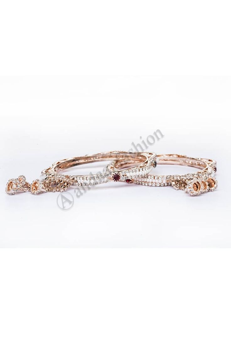 Crystal & Pearl bell hangings bangle set Design No. 80413 Price:- £7.00 Crystal & Pearl studded 2 piece bangle set with bell hangings. For More Details:- http://www.andaazfashion.co.uk/jewellery/bangles/crystal-pearl-studded-2-piece-bangle-set-with-bell-hangings-80413.html