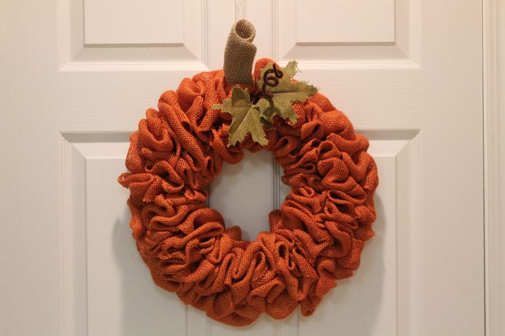 "Here is a burlap pumpkin wreath that is easy to make and just the right accent for those who prefer a more simple touch of fall décor. Follow along and see how quick it is to craft this DIY wreath.Only a few supplies needed:12"" wire floral ring3 rolls of orange burlap 5"" wideSmall piece of tan burlapA few leavesPipe cleanerFloral WireYou will notice the floral ring has 4 wires and 3 spaces. Starting on the outside, run the burlap up between the 1st and 2nd wires. Secure the end of the…"