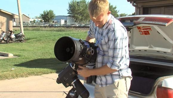 "A student at North Dakota State University displays his telescope, which police mistook for a rifle."" Those damn nerds and their science! Always scaring the crap out of people..."