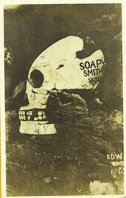 "The Soapy Smith skull (Skagway, Alaska). It was painted on a natural rock formation of a human skull in the 1920s as a tourist dedication to Klondike gold rush bad man, Jefferson Randolph ""Soapy"" Smith."