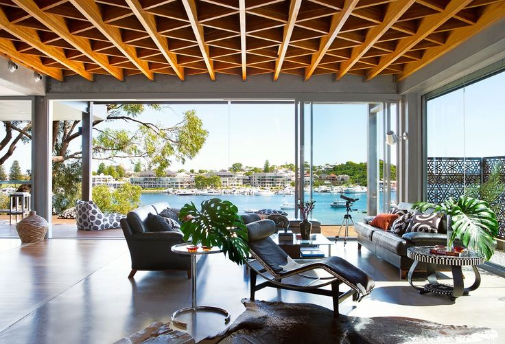 """On a daily basis, it's all about the front deck and kitchen for us,"" says Sue.  Animal hides collected from various countries soften the look of sealed concrete flooring, while the exposed timber joists pick up the decorative theme of the perforated-steel panelling. **Chaise longue** from [DesignFarm](http://www.designfarm.com.au/?utm_campaign=supplier/