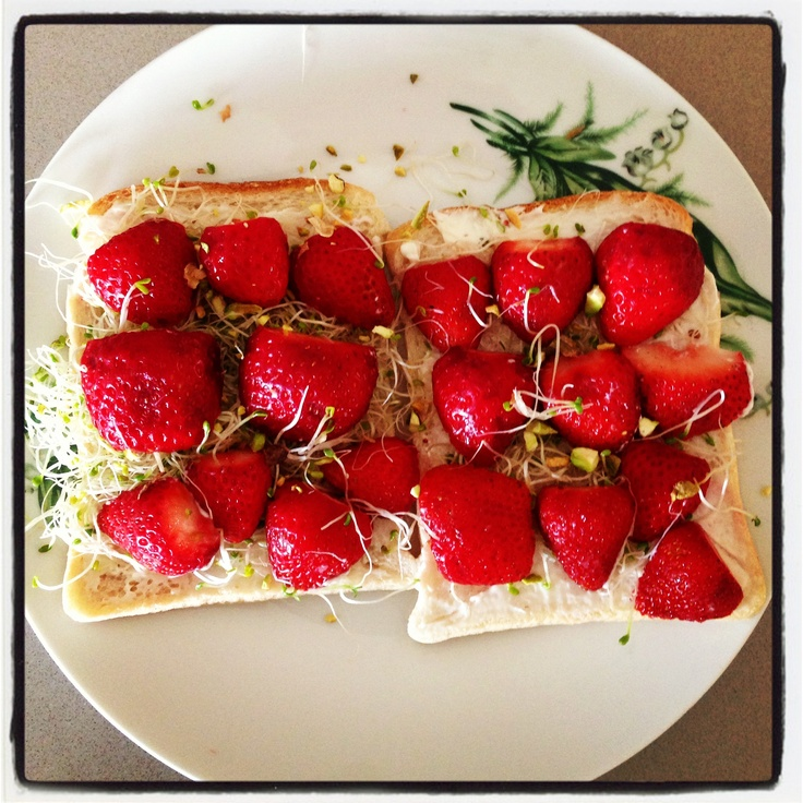My favourite fresh fruit on toast.... Fresh strawberries with low fat cream cheese on low GI toasts.