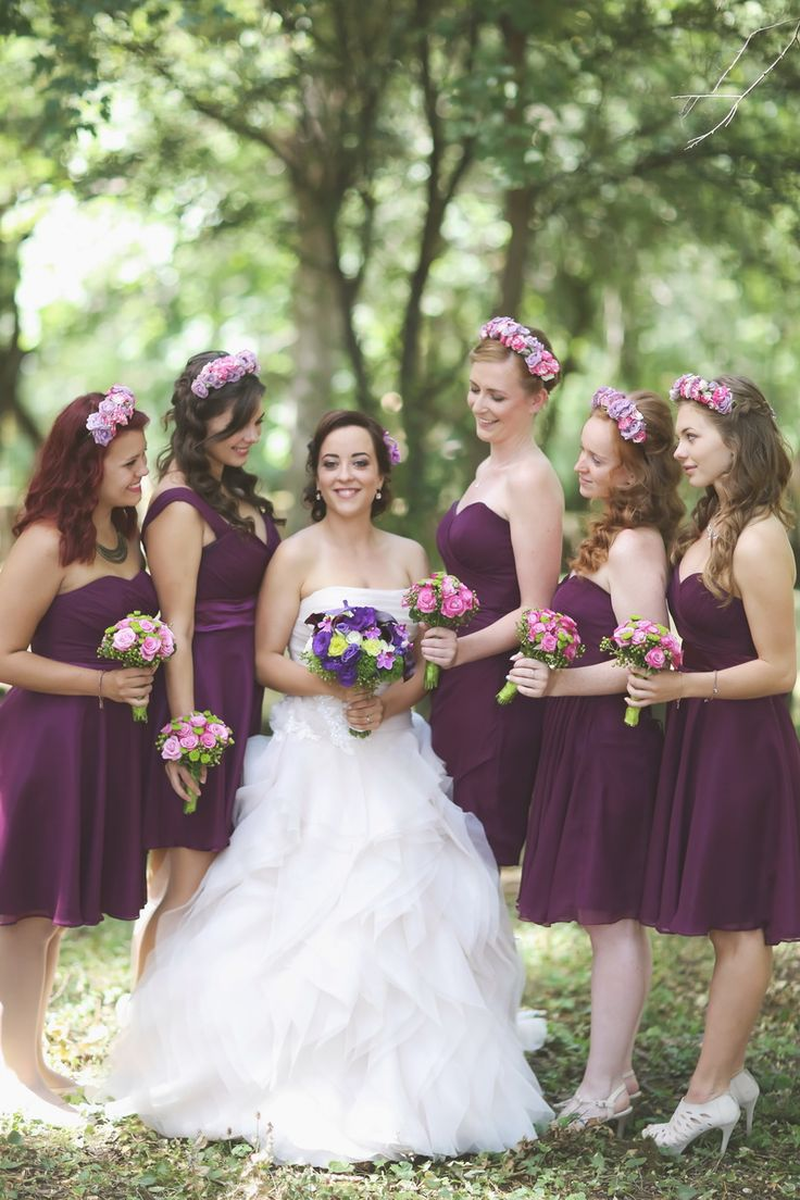 Purple knee-length bridesmaid dresses for summer weddings - the same cut line with different upper piece solutions. Complete with matching bouquets and headbands.