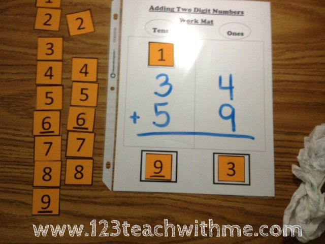 Math Mat -- Double Digit Addition with regrouping - love that this is reusable and tactile (makes them think about re-grouping the ten since they need to physically put a number card in the box.