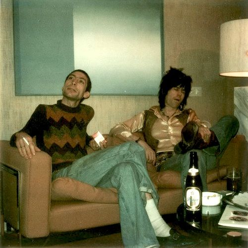 #TIMELESSTIME ➪ Mick Jagger, Charlie Watts and Keith Richards relaxing on a couch and enjoying time together, while the Rolling Stones are looking for a new guitarist to replace Mick Taylor, who has just left the group. The photo was taken on December 12, 1974 in the Hilton Hotel, Munich. © Dominic Lamblin.
